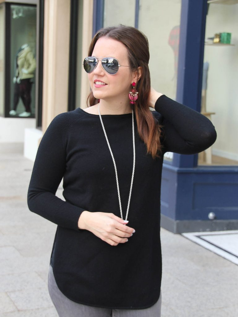Houston Fashion Blogger wears a black wool cashmere sweater with dark pink statement earrings for a winter outfit idea.