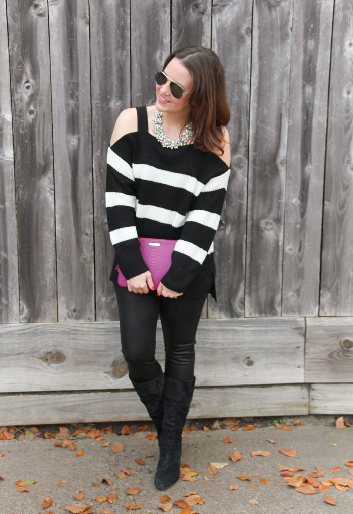 Houston Style Blogger Lady in Violet wears a casual New Year's Eve outfit featuring leather leggings and suede boots with a striped sweater.