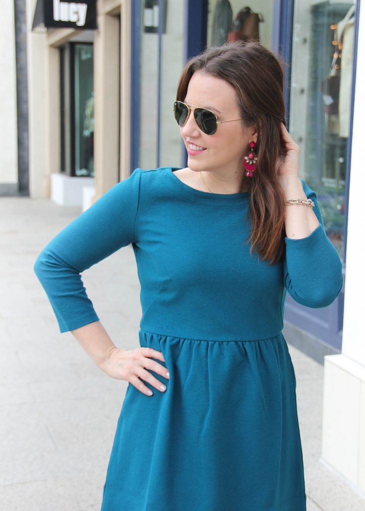 Houston Style blogger Lady in Violet wears the Baublebar Venette drops in berry with the teal ottoman flare dress from Loft.