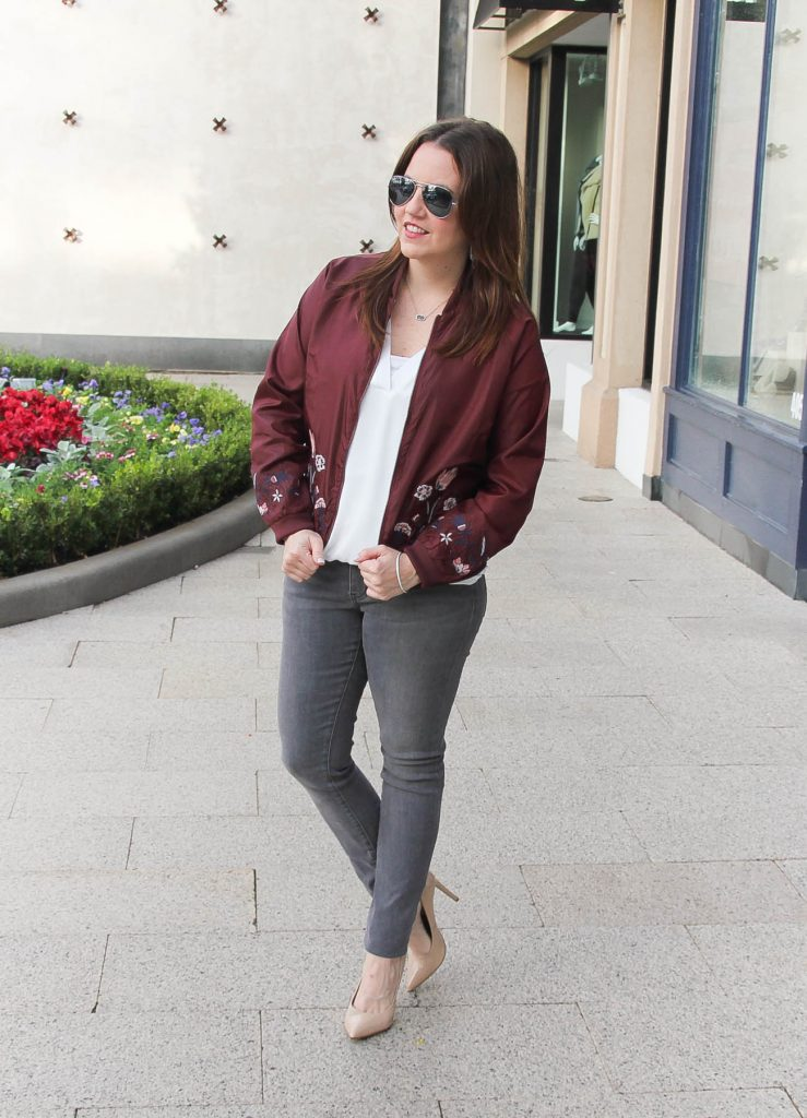 Houston Fashion Blogger Lady in Violet shares a casual weekend outfit idea featuring gray jeans and a maroon bomber jacket.