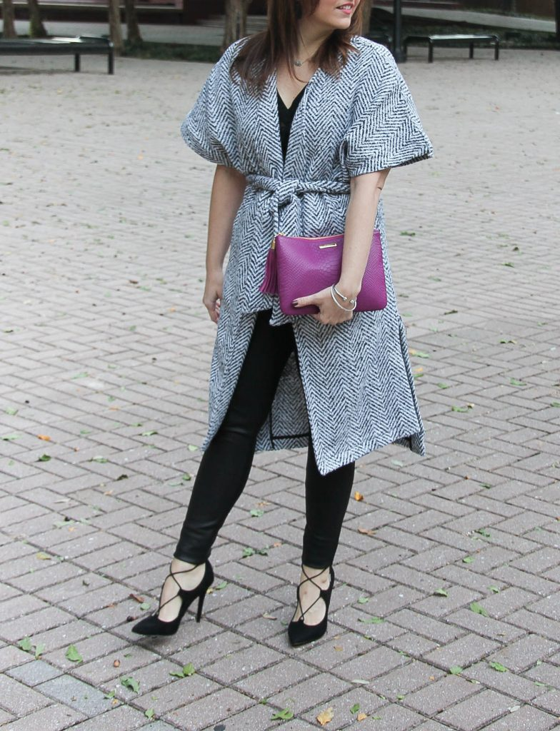 Houston fashion blogger, lady in violet wears a chic holiday outfit with leather leggings and a wrap coat.