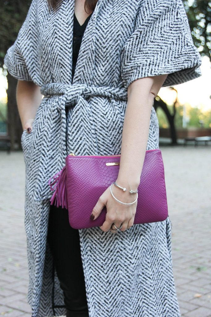 Houston fashion blogger Lady in Violet wears a dao chloe dao wrap coat and gigi ny clutch with the henri bendel bracelet.