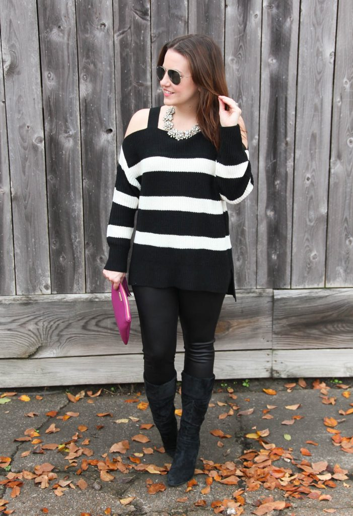 Houston Style Blogger, Karen Rock styles a winter outfit idea for a party featuring a cold shoulder sweater, faux leather leggings, and suede boots.