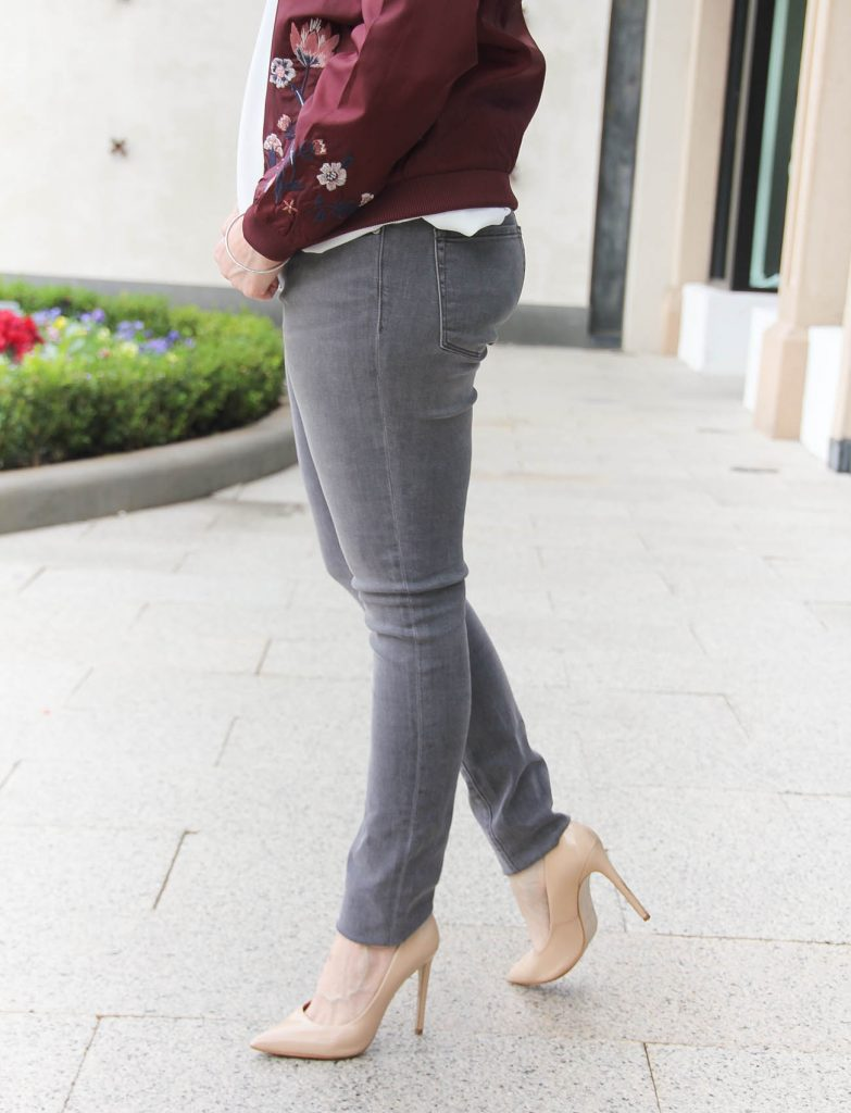 Houston Fashion Blogger Lady in Violet wears gray skinny jeans under 100 dollars with nude heels.