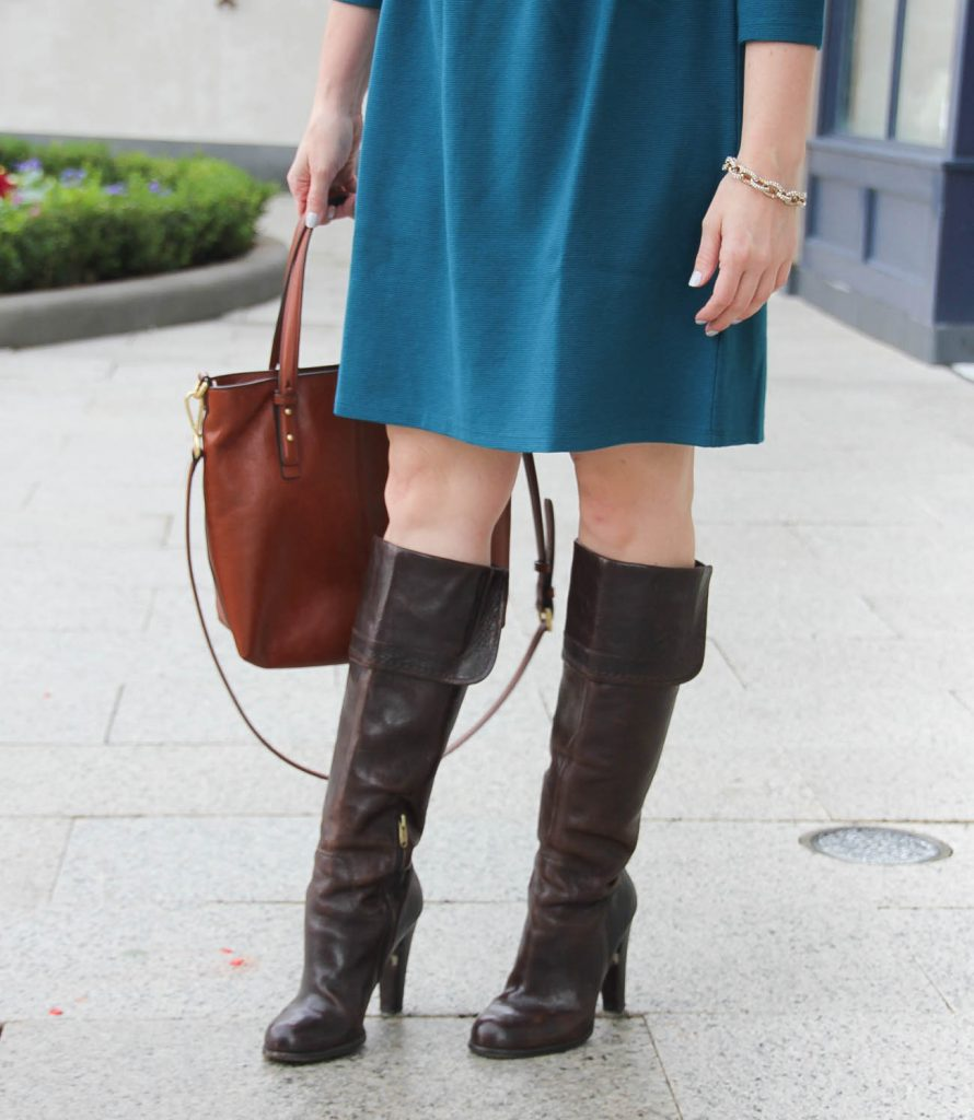 Houston Fashion Blogger wears Joan and David brown heeled boots with a teal dress.