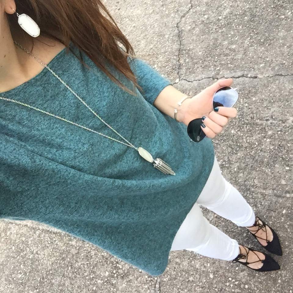 Houston Fashion Blogger wears a winter outfit with white jeans and teal sweater.