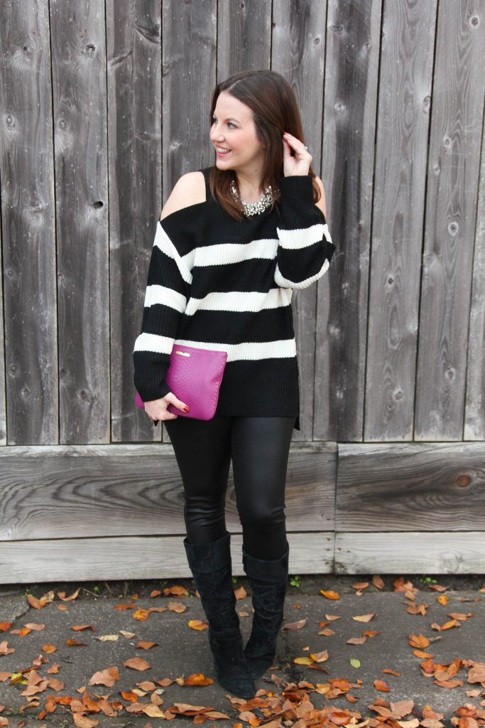 Houston Fashion Blogger, Karen Rock of Lady in Violet styles a casual New Years Eve outfit for cold weather with faux leather leggings and a cold shoulder sweater.