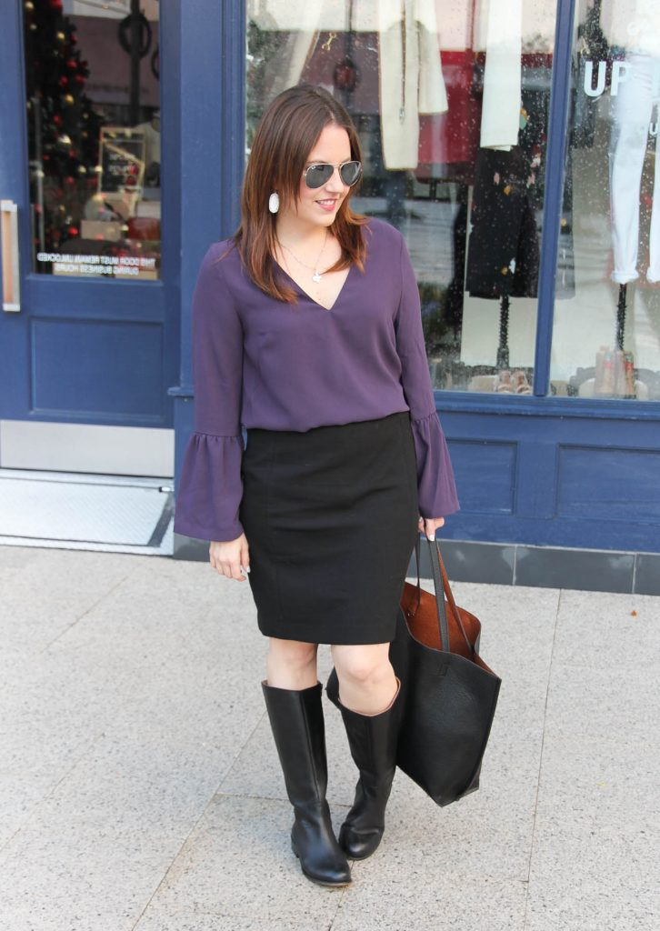 Houston Style Blogger Lady in Violet wears an office outfit idea featuring a purple bell sleeve blouse and black riding boots.