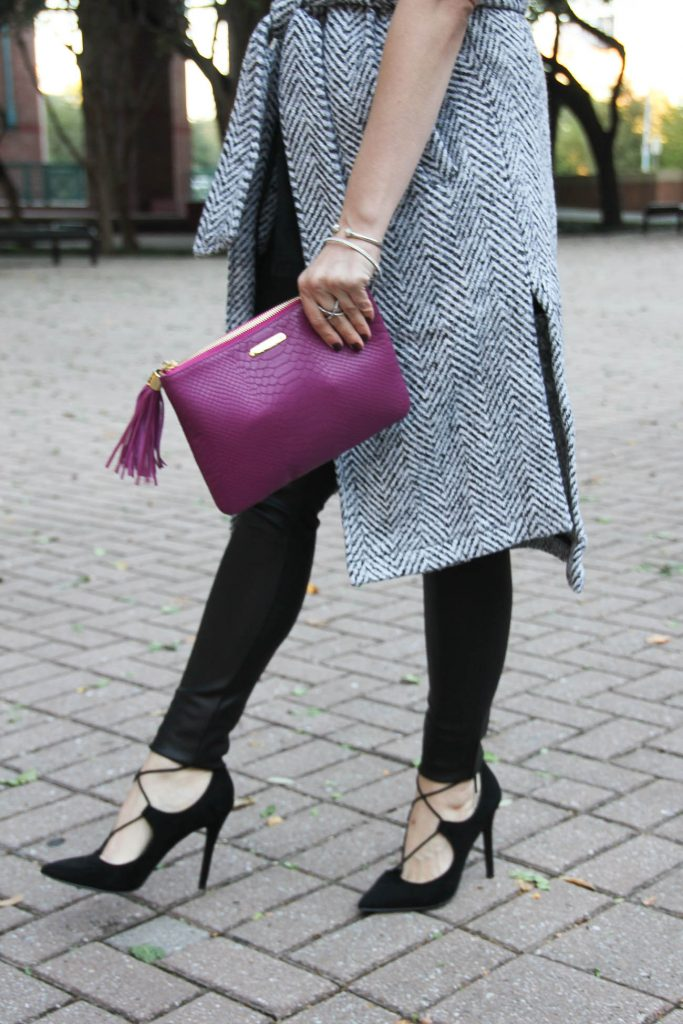 Houston fashion blogger Lady in Violet wears a winter outfit with leather leggings, long gray coat, and lace up heels.