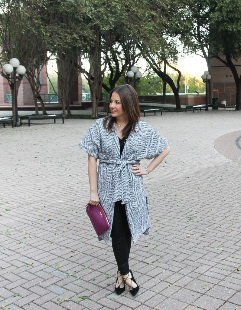 Houston fashion blogger Lady in Violet styles a holiday party outfit idea with coat, faux leather leggings and lace up heels.