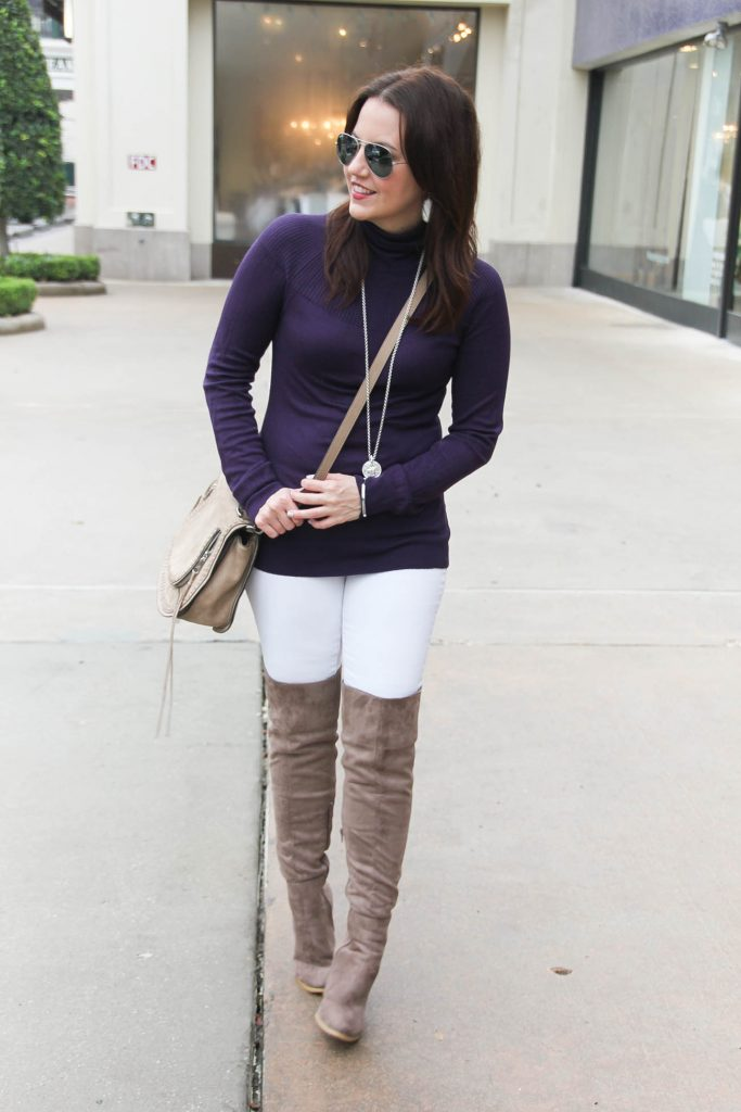 Houston Fashion Blogger Lady in Violet styles a winter outfit idea featuring a purple sweater, white jeans, and over the knee boots. Click through for outfit details.