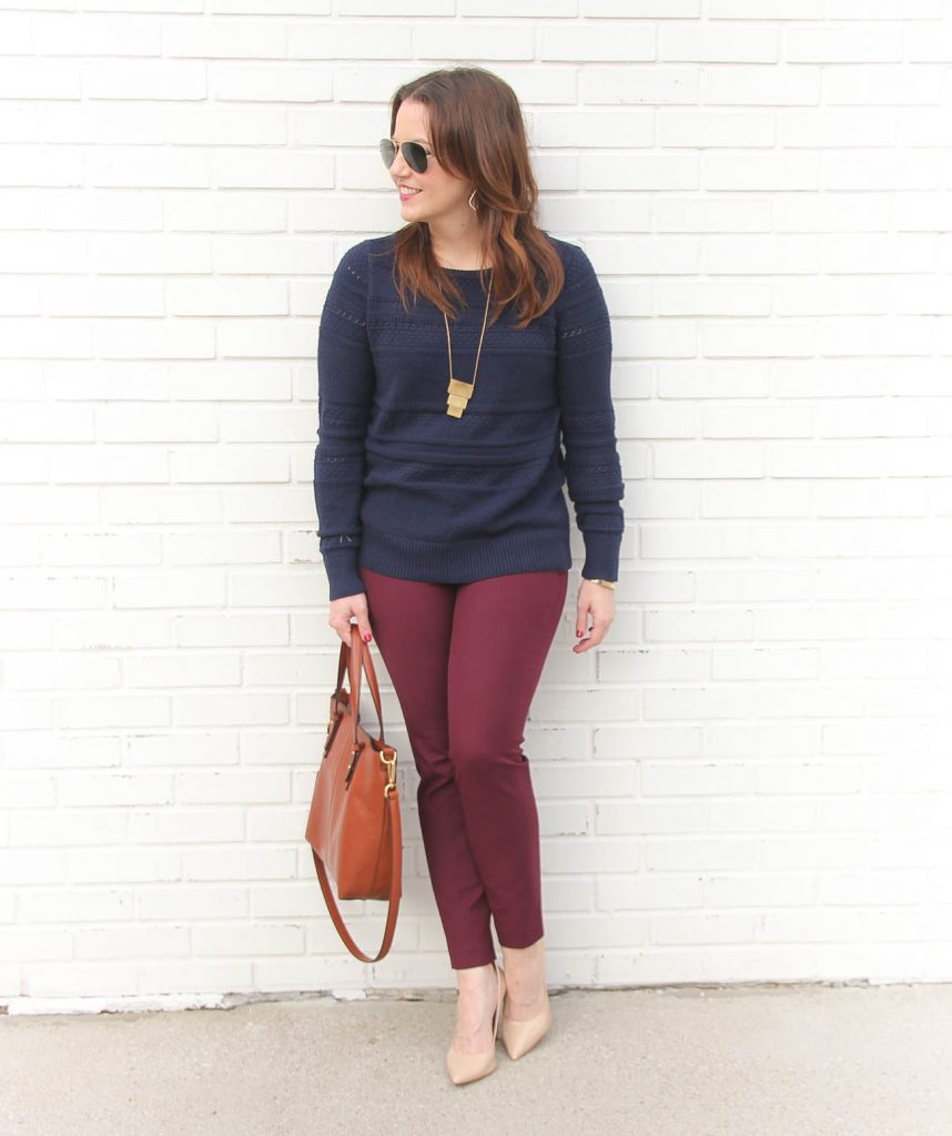 5fa16930c7 Houston Fashion Blogger Karen Rock wears a winter work outfit featuring a  navy sweater and burgundy