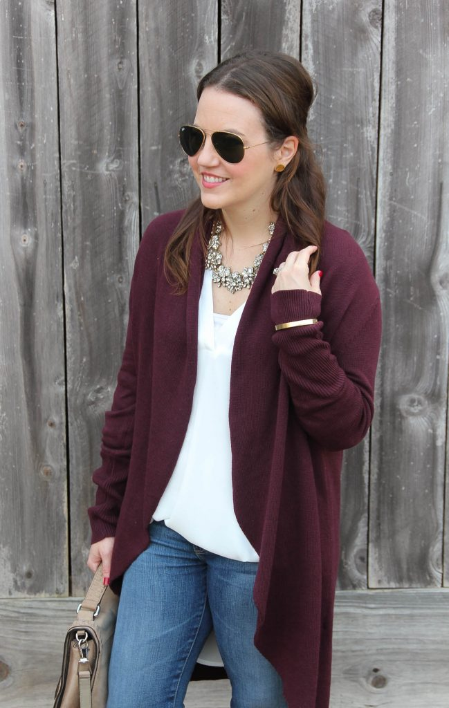 Houston Style Blogger Lady in Violet wears a casual weekend outfit including a maroon long cardigan with a white tunic and AG jeans.