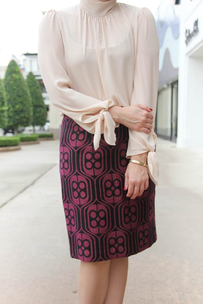 Houston Fashion Blogger Lady in Violet styles an office outfit featuring a pencil skirt and high neck blouse. Click through for outfit details.