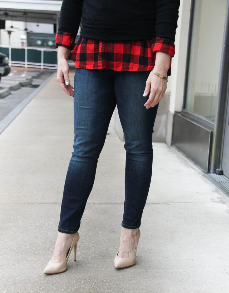 Houston Fashion Blogger wears a buffalo plaid top with a black sweater and skinny jeans. Click through for outfit details.