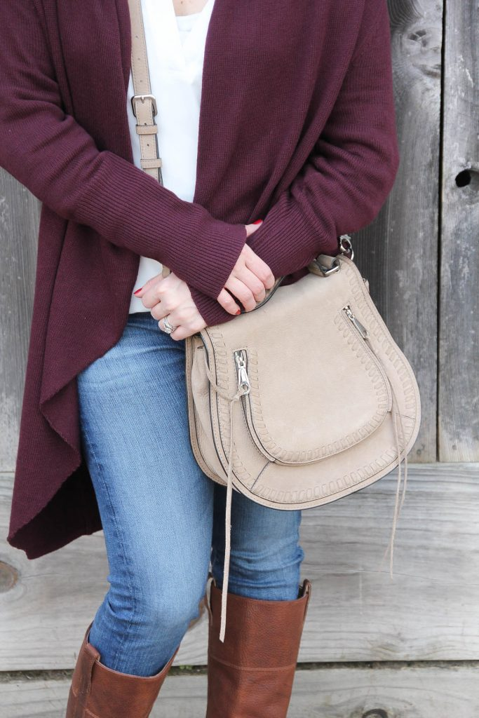 Houston Fashion Blogger Lady in Violet carries the Rebecca Minkoff Vanity Saddle Bag as part of a casual winter outfit idea.