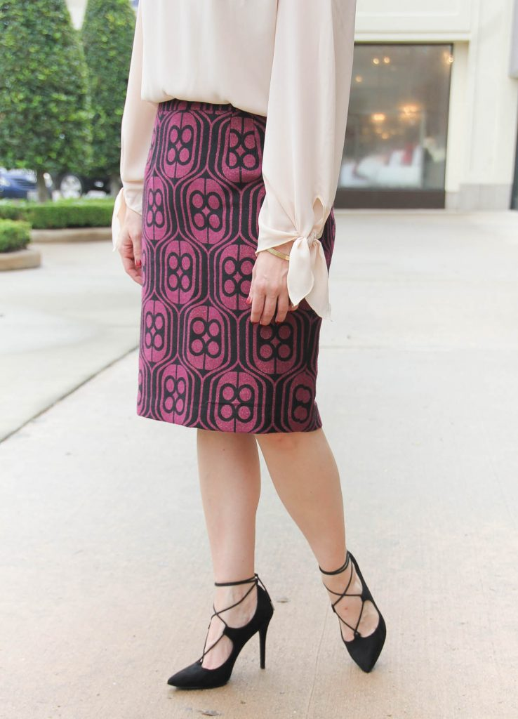 Karen Rock of Lady in Violet the Houston Fashion Blog wears black lace up heels for work with a Trina Turk pencil skirt. Click through for outfit details.