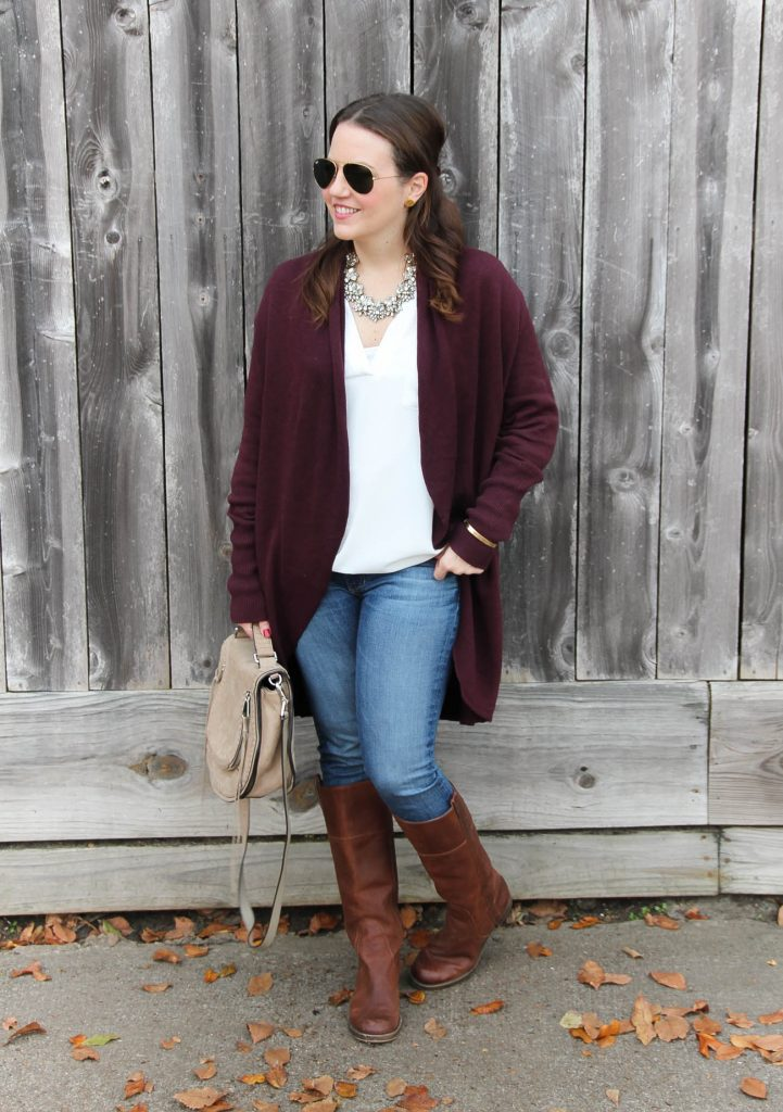 Houston Fashion Blogger styles a casual winter outfit for warm weather with riding boots and a long cardigan.