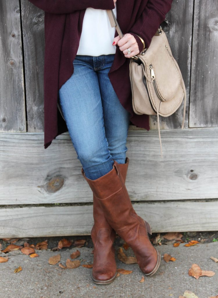 Houston Blogger Lady in Violet shows how to wear riding boots with ag skinny jeans and a maroon cardigan.
