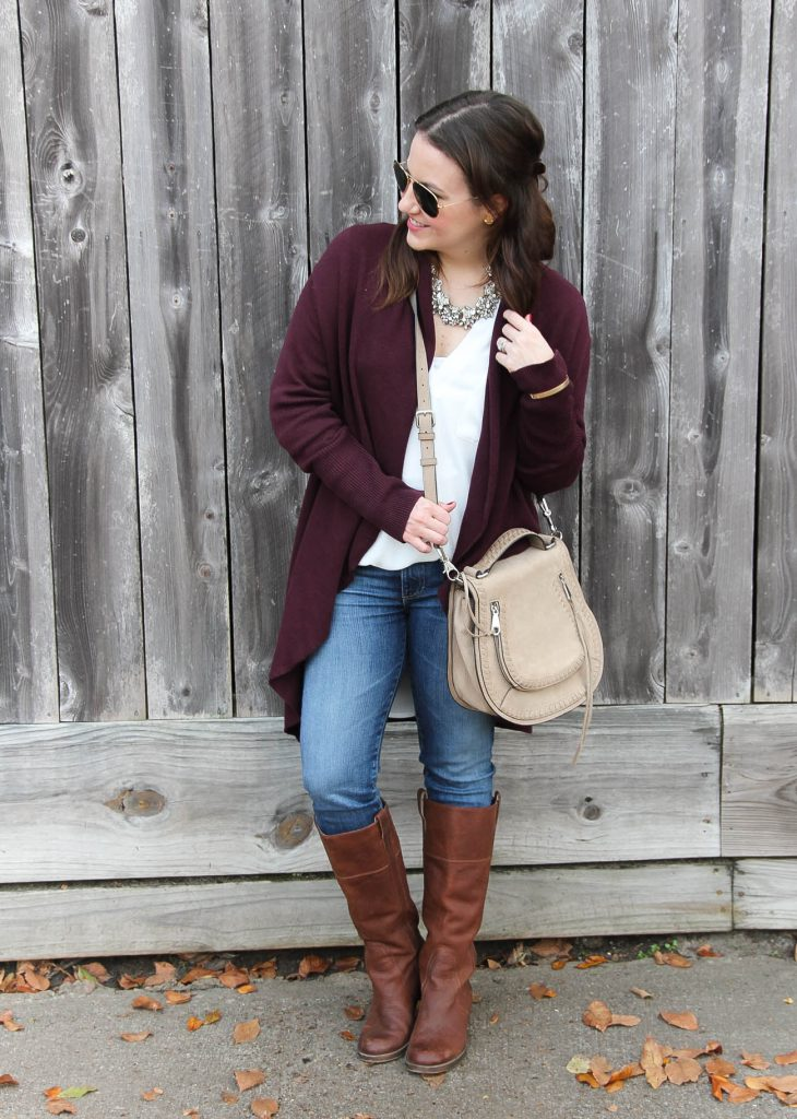 Houston Style Blogger wears a cute fall outfit idea with layers including a long cardigan, white blouse and jeans.