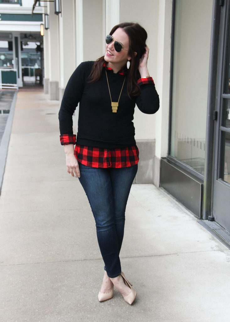Houston Fashion Blogger Lady in Violet styles a winter outfit idea for casual Friday at the office featuring a black sweater with a red plaid shirt. Click through for outfit details.