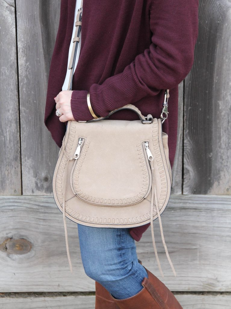 Lady in Violet carries a neutral saddle bag similar to the Chloe Marcie Purse.