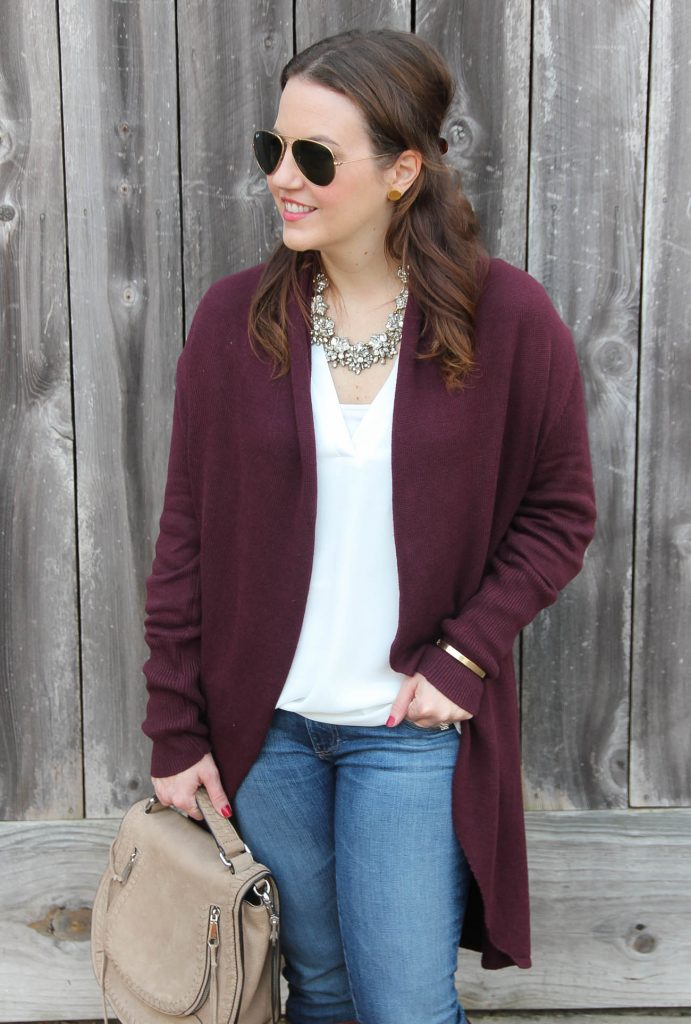 Houston Fashion blogger styles a casual weekend outfit with statement necklace and burgundy circle cardigan.