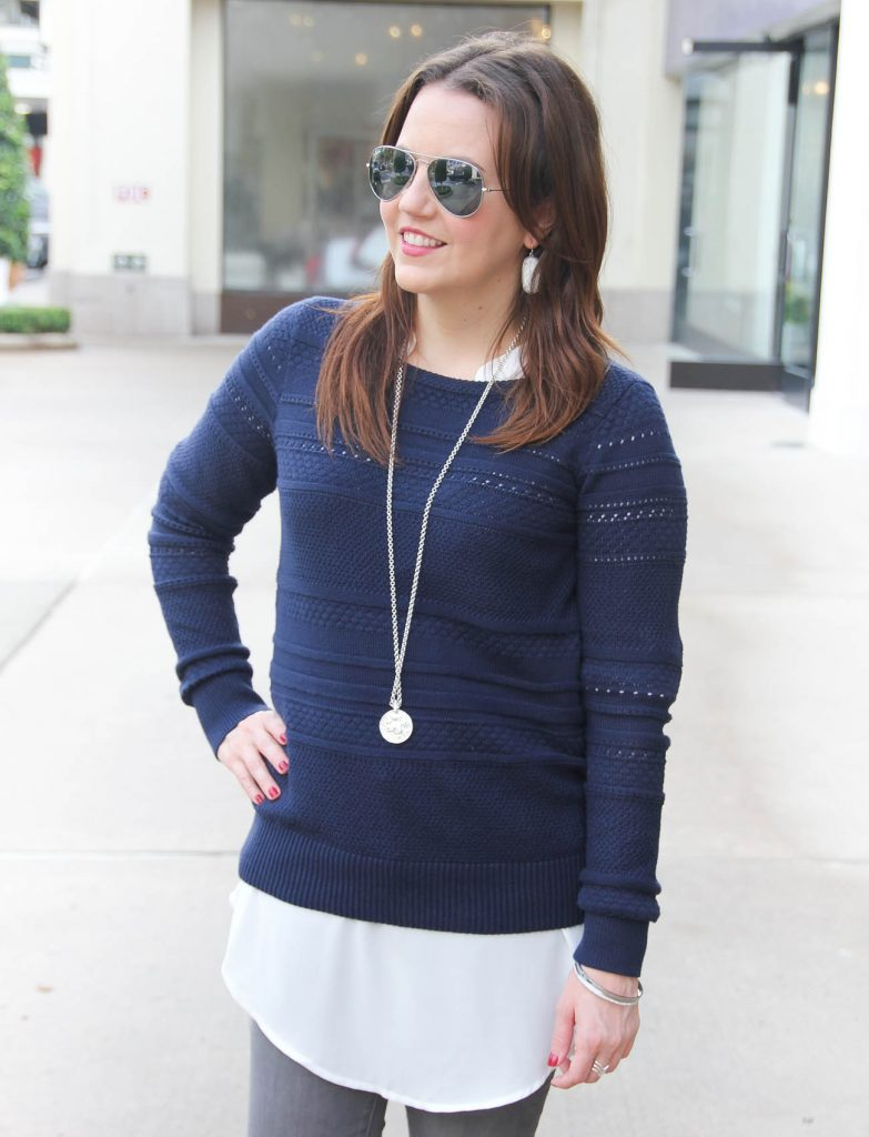 Houston Blogger Lady in Violet styles a layered winter outfit idea featuring a navy sweater and long white blouse. Click through for outfit information.
