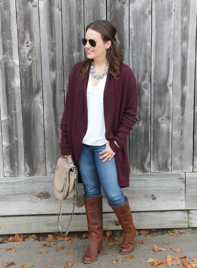 Houston Fashion Blogger Lady in Violet wears a casual cold weather outfit with layers including a long cardigan paired with skinny jeans and brown riding boots.