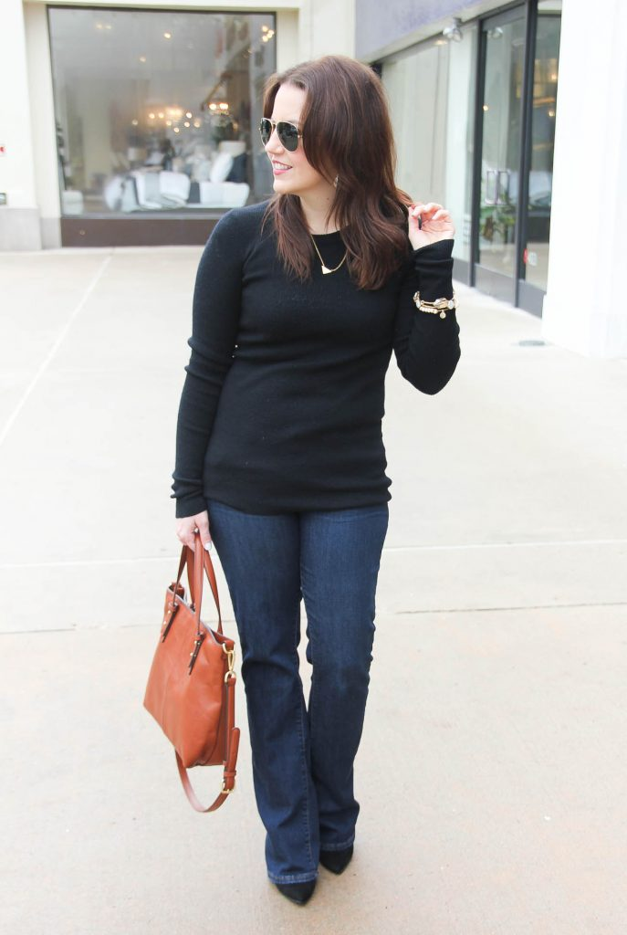 Lady in Violet, a Houston based Fashion Blogger styles a Casual Friday outfit for winter including a black ribbed knit sweater and flared jeans.