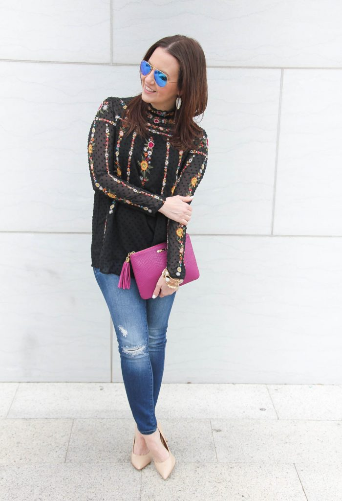 Houston Fashion Blogger wears a weekend outfit idea including a floral embroidered blouse with distressed jeans.