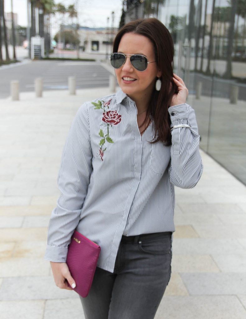 Lady in Violet, a Houston based fashion blogger, styles a rose embroidered blouse and shares how to half tuck a shirt in jeans.