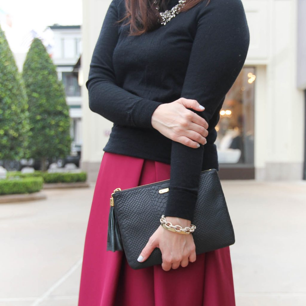 Houston Fashion Blogger styles a Valentine's Date night outfit idea featuring a sweater and pink skirt.