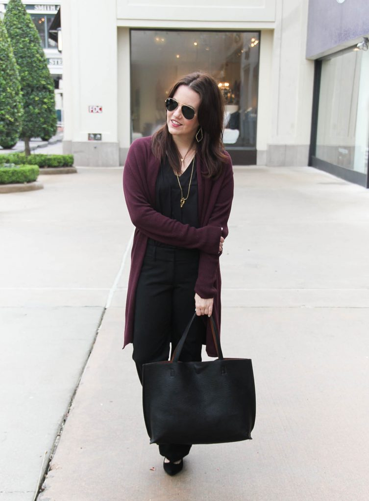 Houston Style Blogger wears a chic office outfit featuring black pants and a burgundy long cardigan.