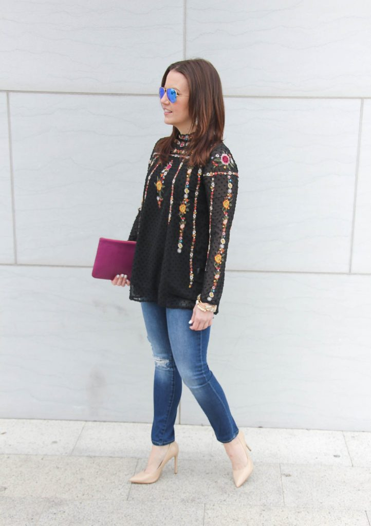 Karen Rock, a Houston Fashion Blogger styles a date night outfit idea including a floral embroidered top with distressed jeans and nude heels.