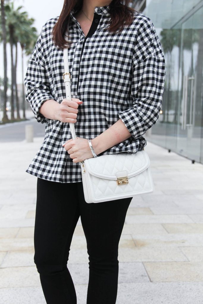 Houston blogger wears a Vera Bradley leather purse with a gingham blouse for spring.
