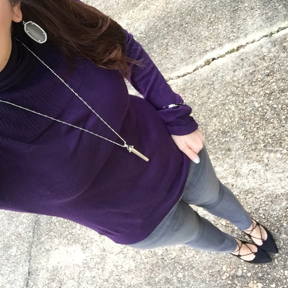 Houston blogger styles gray jeans with a purple turtleneck for a casual winter outfit.