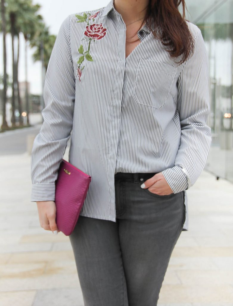 Houston personal style blogger wears a dressed up casual outfit for happy hour including a floral embroidered blouse and gray jeans.