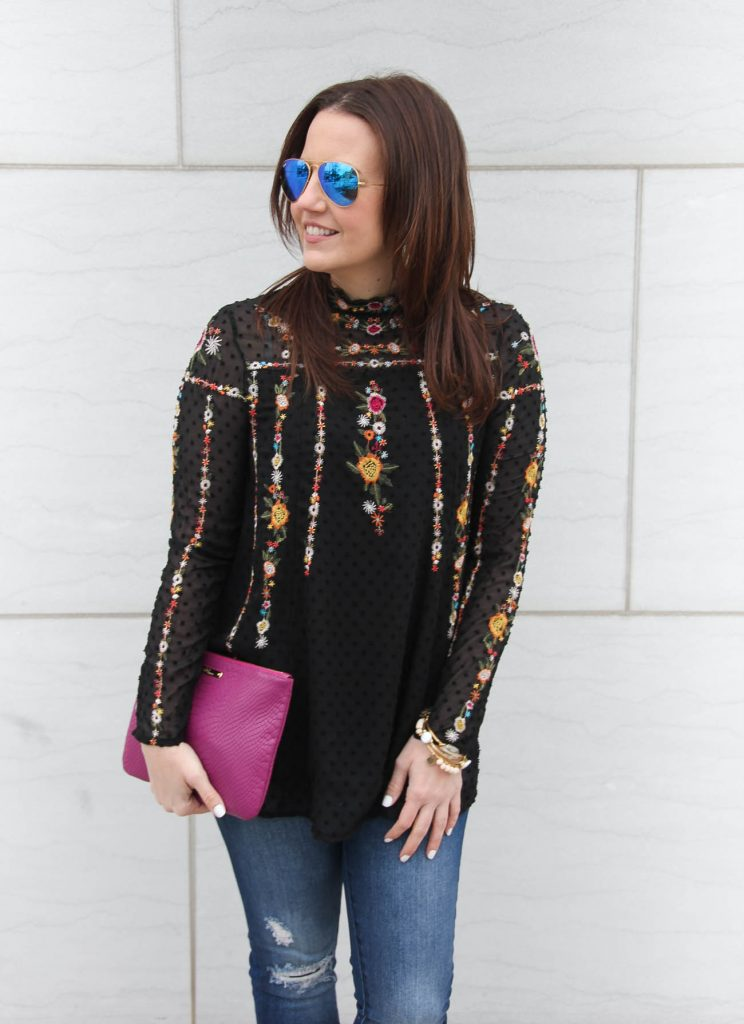 Houston Fashion blogger talks fashion trends in top featuring sheer sleeves and floral embroidery.