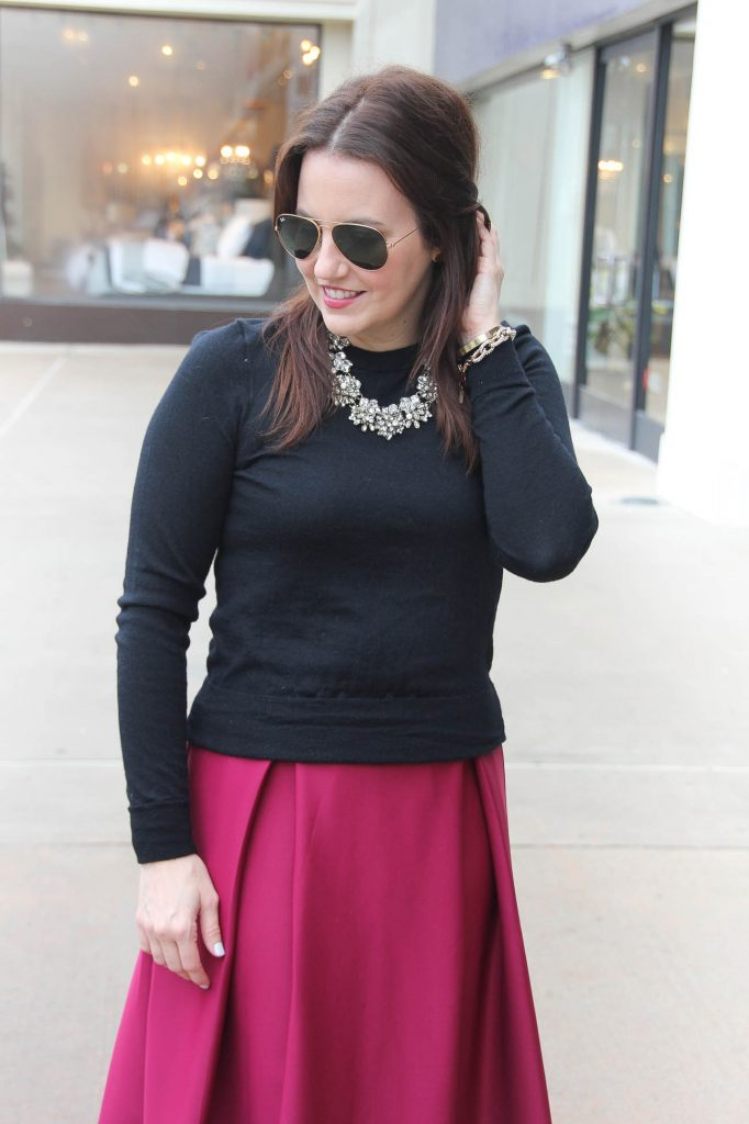 Karen Rock, a Houston Fashion Blogger styles a date night outfit for Valentine's Day featuring a midi skirt and black sweater.