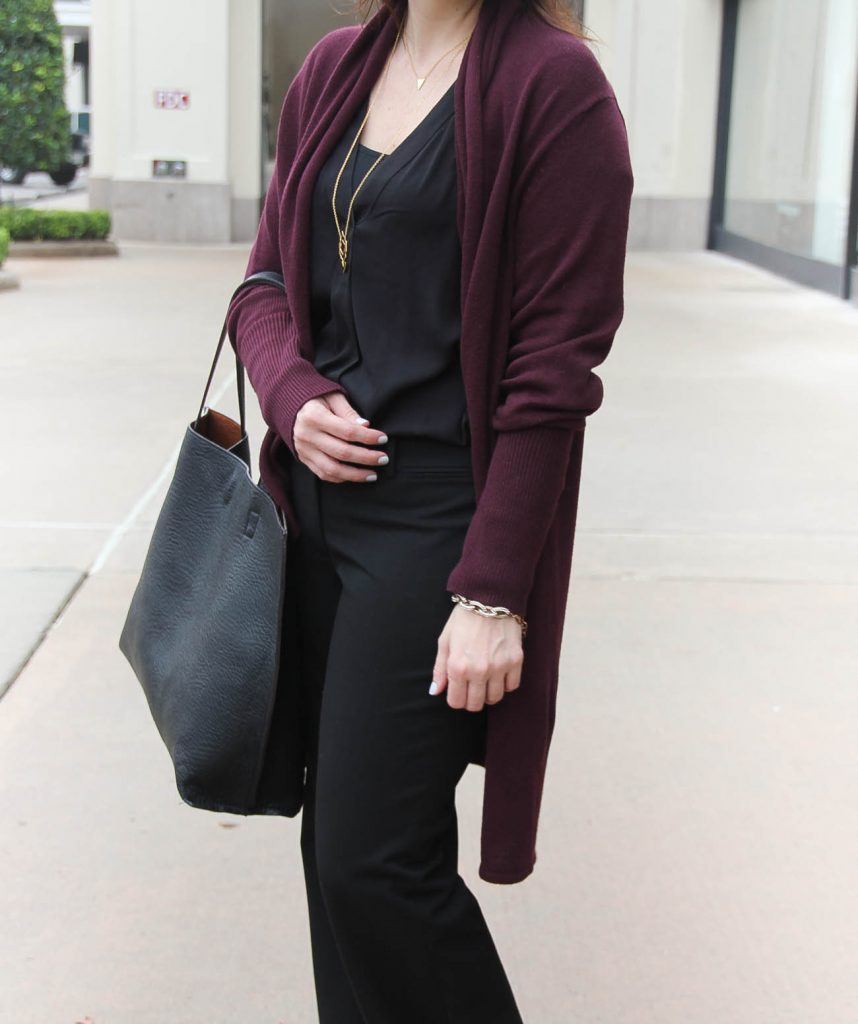 Houston Fashion Blogger styles an office outfit by layering a black blouse with a long cardigan.
