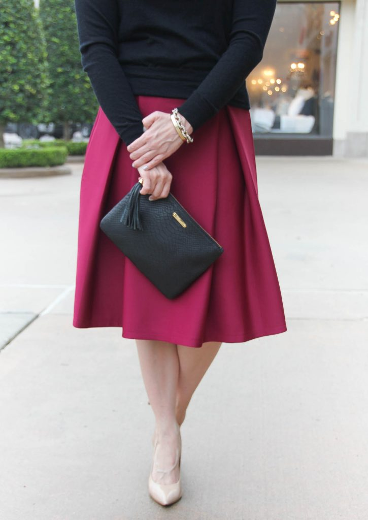 Lady in Violet, a Houston fashion blogger wears a Chicwish midi skirt with a J Crew sweater and Gigi New York clutch.