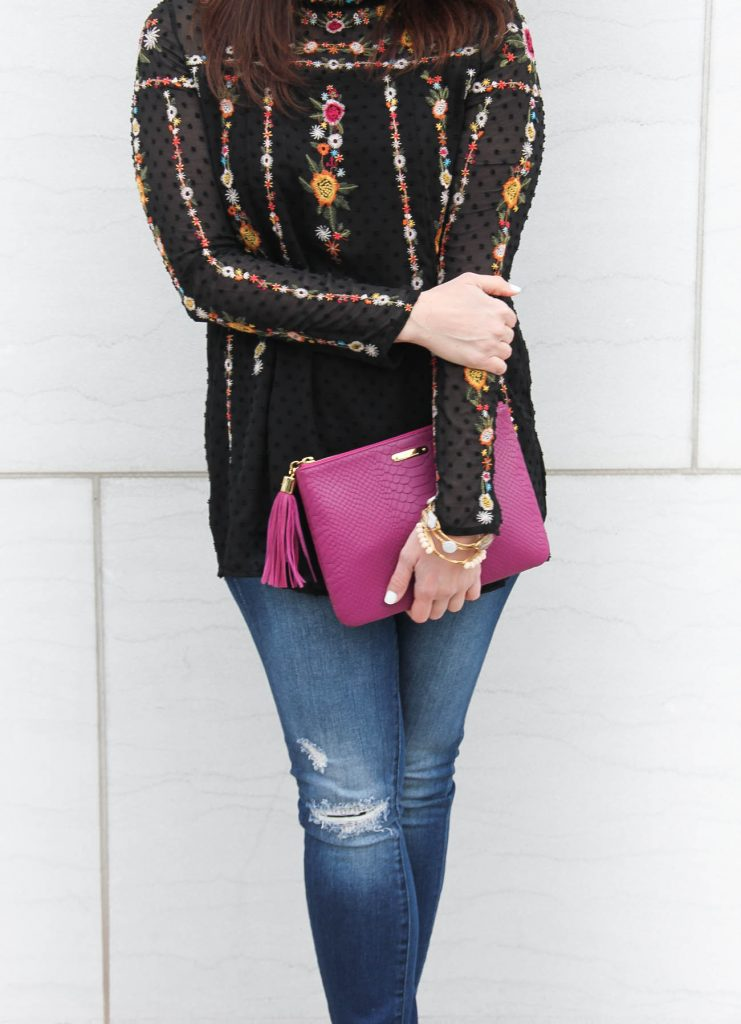 Karen Rock, a Houston area fashion blogger wears Chicwish top with blank denim distressed jeans.