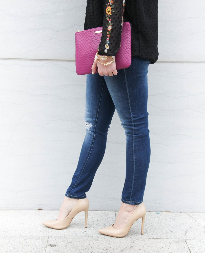 Lady in Violet, a Houston Fashion Blogger wears a jeans and heels outfit for girls night out.