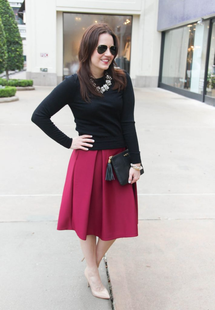 Lady in Violet, a Houston style blogger wears a winter date night outfit idea featuring a pink midi skirt and sweater. Perfect for Valentine's Day!