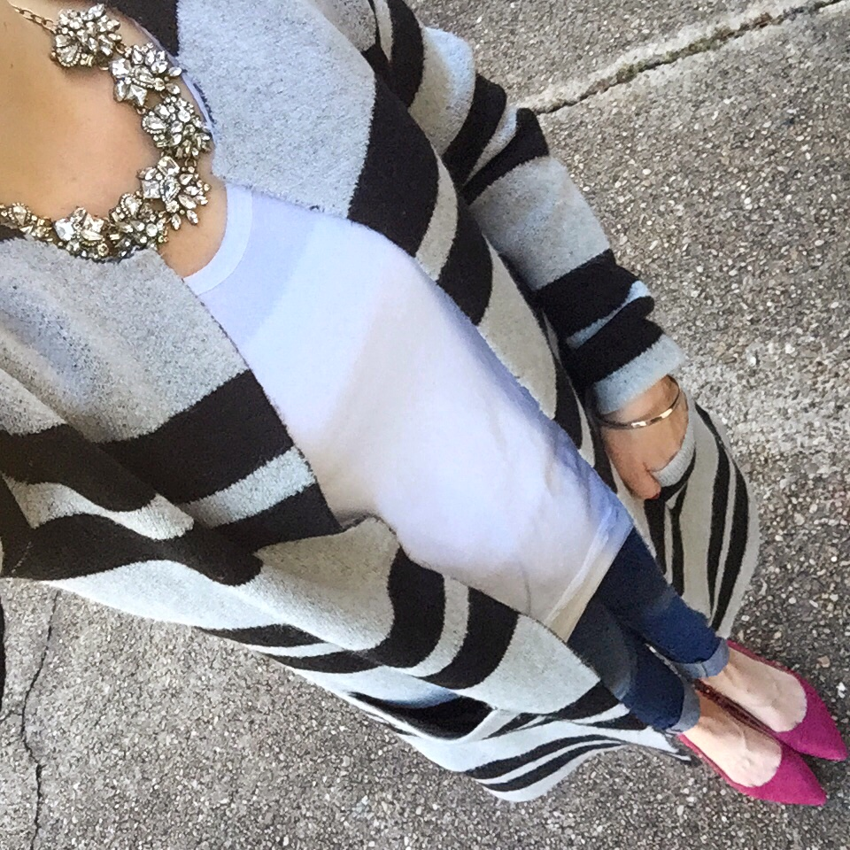 Houston fashion blogger wears a casual winter outfit featuring a striped cardigan.