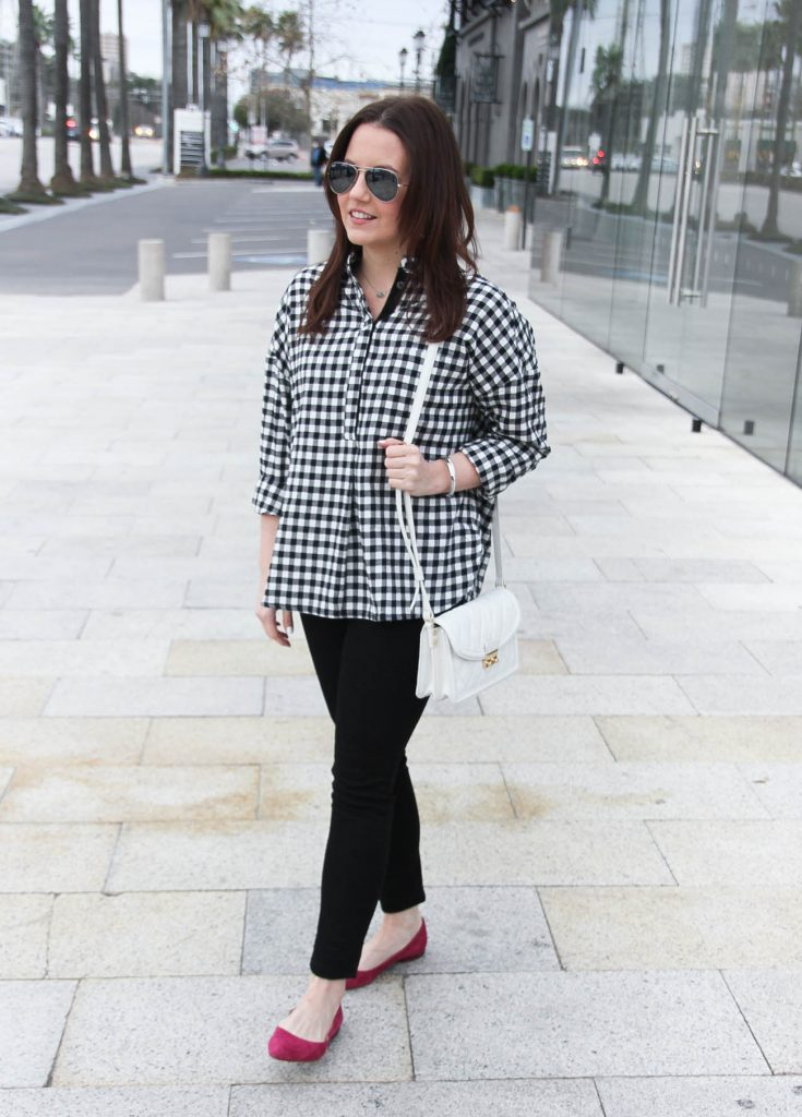 Lady in Violet, a Houston based fashion blogger wears a weekend outfit idea including a gingham blouse with black jeans.