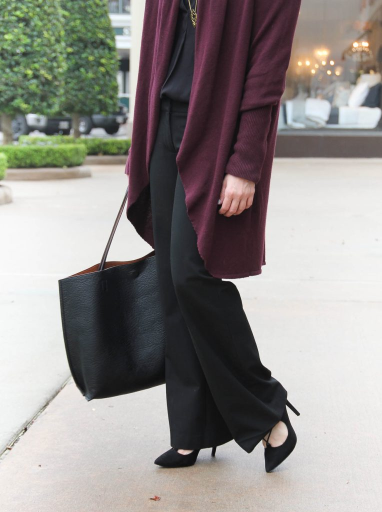 Lady in Violet shares what to wear to work in winter including a long cardigan and black slacks.
