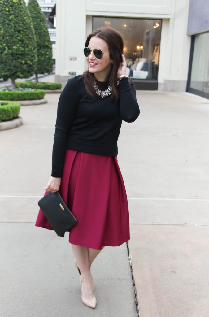 Houston fashion blogger wears a valentine's day date night outfit including a midi skirt paired with a sweater.