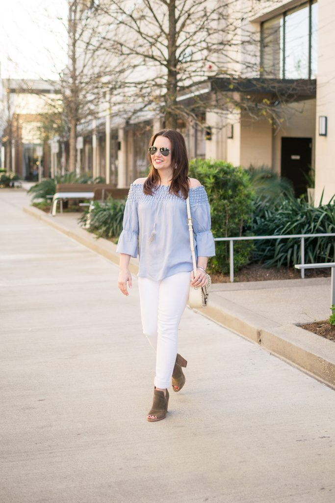 Houston Fashion Blogger, Lady in Violet styles a spring outfit idea including a blue off the shoudler top with white jeans and brown peep toe booties.